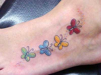 tattoos de borboletas no pé