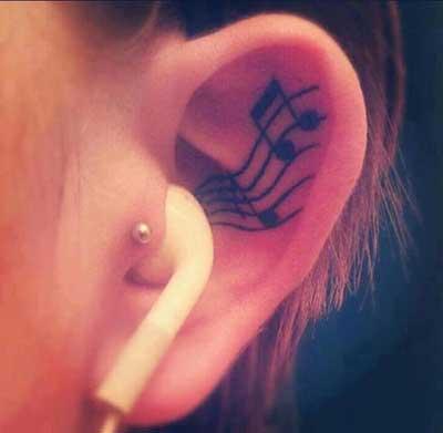 Fotos de Tatuagens de Notas Musicais