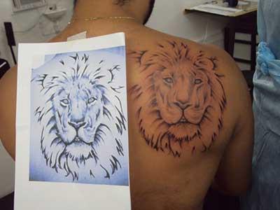 fotos de tatuagens de leão