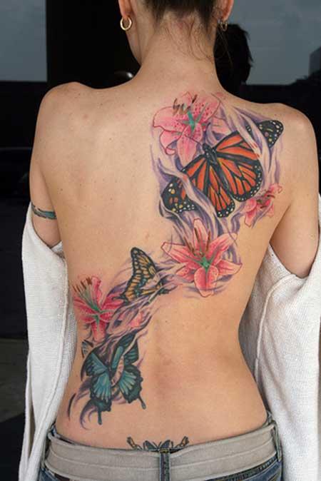 tatuagens femininas nas costas borboletas coloridas